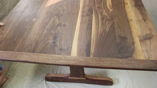 Rubus Woodworks Walnut trestle table with beadboard ends