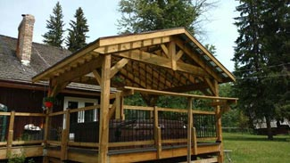 Rubus Woodworks Craftsman-style roof system  built over hot tub and bbq area