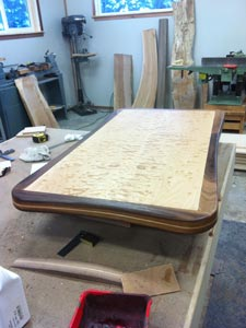 Rubus Woodworks Quilted maple table with walnut accents